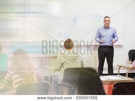 Digital composite of teacher with class