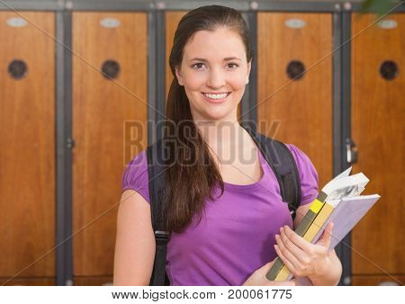 Digital composite of female student holding files in front of lockers