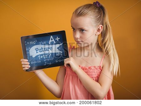 Digital composite of Girl holding a tablet with school icons on screen