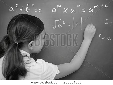 Digital composite of Girl writing math equations on blackboard