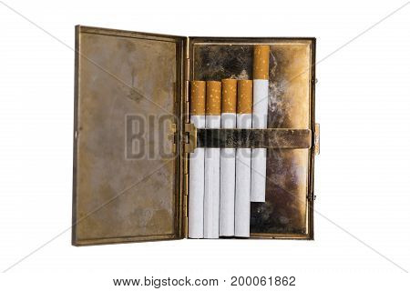 Shiny metal old vintage used scratched shabby opened cigarette case with corrosion and five new cigarettes with orange filters on isolated white background.