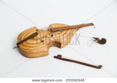 Old vintage wooden broken retro small yellow beautiful violin with bows on white background.
