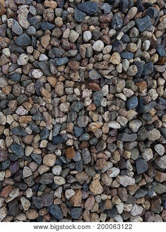 Photo of multi-colored coastal pebbles, texture, background