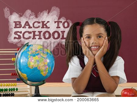 Digital composite of Student girl at table against red blackboard with back to school text