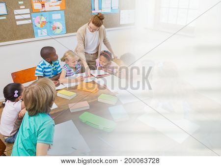Digital composite of Elementary school teacher teacher with class