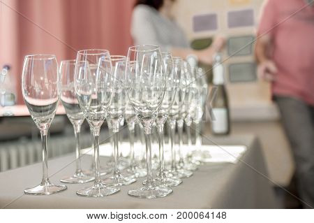 Strung champagne glasses stand on a table