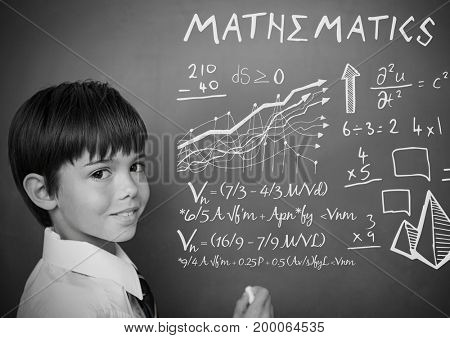 Digital composite of mathematics text and equations on blackboard with boy