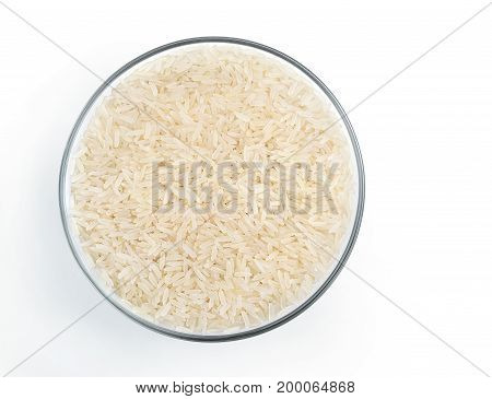 Healthy food. Parboiled rice in glass bowl isolated on white background. Top view. Copy space. High resolution product.