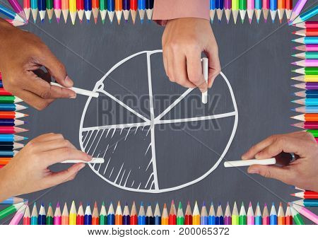 Digital composite of Hands drawing pie chart on blackboard with coloring pencils