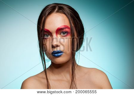 Beautiful young model with creative make up and hairstyle. Beauty and fashion. Artistic on stage make up