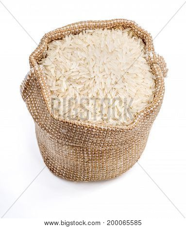Burlap sack filled parboiled rice isolated on white background. Healthy food. Close up top view high resolution product