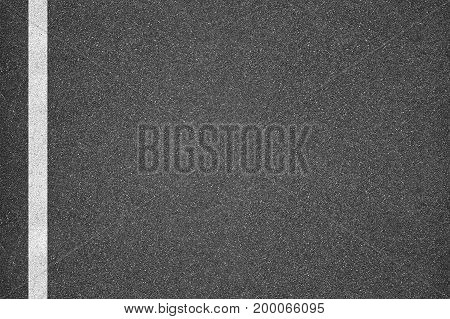 Asphalt texture background with one white line