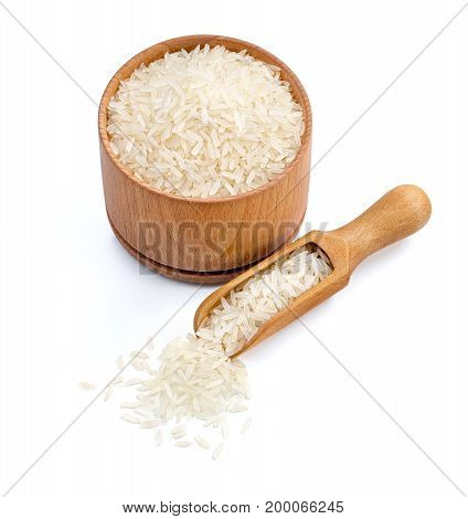 Healthy food. Wooden bowl and scoop with parboiled rice isolated on white background. Healthy food. Copy space. High resolution product