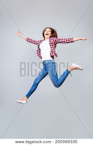 I Can Fly! Happiness, Dream, Fun, Joy Concept. Very Excited Happy Cute Brunette Girl Is Jumping Up,