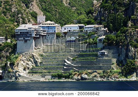Athos peninsula, Greece. The Monastery of Dionysiou located in the Republic of Monks on the peninsula of Athos. View from a cruise ship.