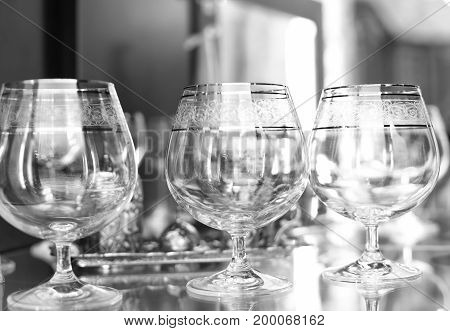 Empty  cognac  glasses . Black and white photo