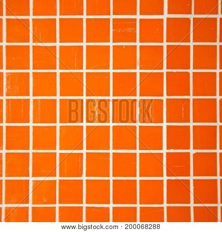 Orange mozaic tile. Beautiful decoration on a wall