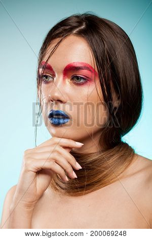 Gorgeous beautiful young model with creative make up and hairstyle. Beauty and fashion. Artistic on stage make up