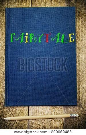 Notebook with inscription fairytale on wood .