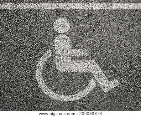 Disabled parking sign on asphalt in backgrounds