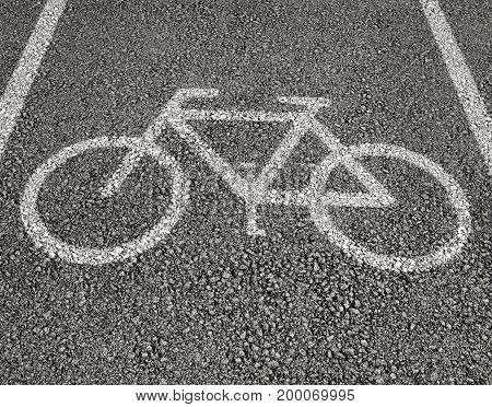 Bicycle sign close up on asphalt .