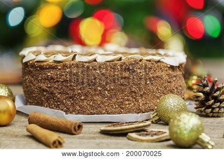 Chocolate cake near Christmas decoration close up