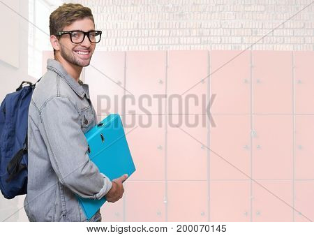 Digital composite of male student holding folder in front of lockers