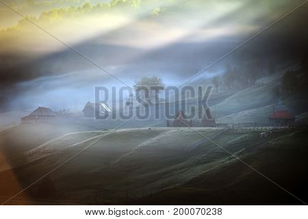 mountain landscape with autumn morning fog at sunrise - Fundatura Ponorului, Romania