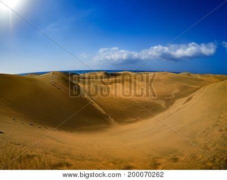 sand dunes on the beach under summer hot sun