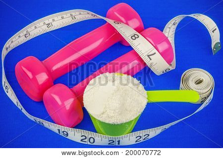 Dumbbells with tape measure and whey powder