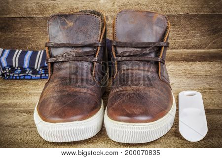 Desert boots in brown with socks in backgrounds