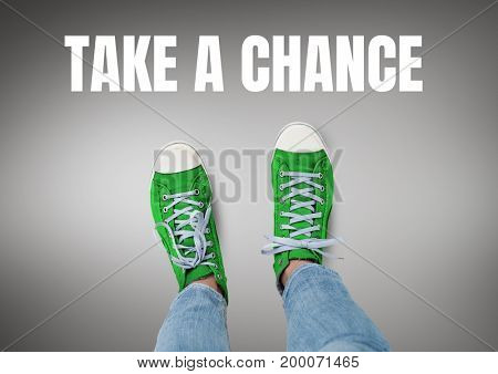 Digital composite of Take a chance text and Green shoes on feet with grey background