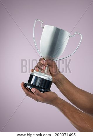 Digital composite of Person holding a trophy on hands