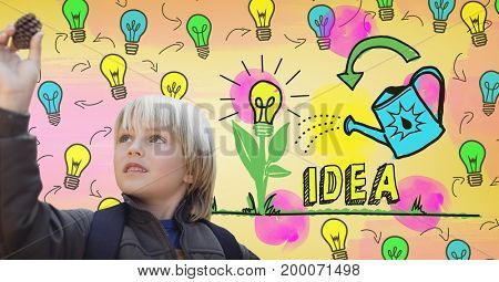 Digital composite of Boy looking at pine cone with colorful idea light bulbs graphics