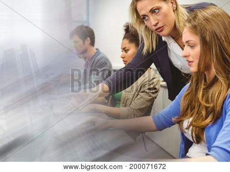 Digital composite of teacher with class on computers