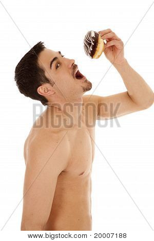 Man Holding Doughnut Above Mouth