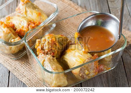Stuffed pepper with sauce in a container