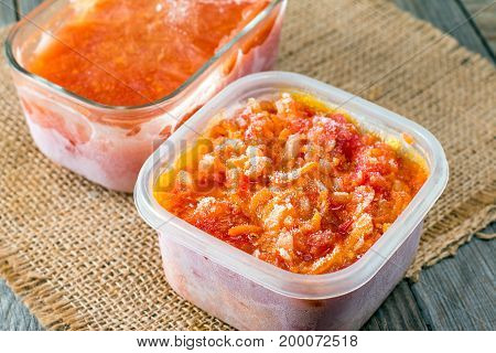 Frozen gravy from carrots and onions on a wooden background