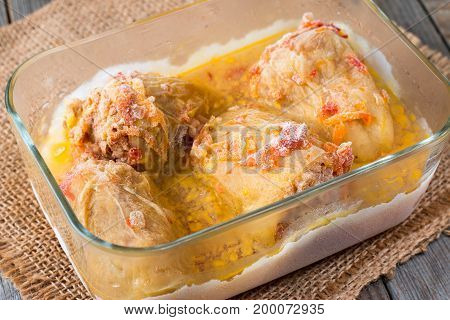 Stewed frozen stuffed pepper in a glass container. Frozen food