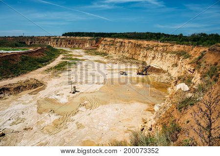 Work of excavator and quarry truck on limestone mining in a quarry