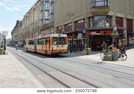 Geneva Switzerland June 3, 2014 : tramcar on street in downtown and business district in Geneva