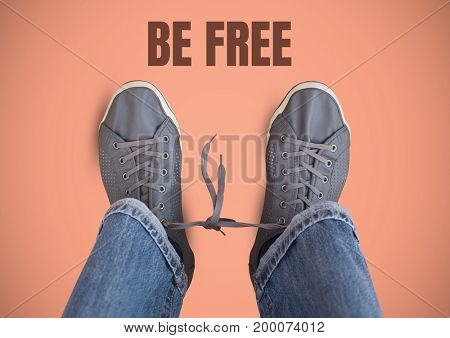 Digital composite of Be free text and Grey shoes on feet with pink background