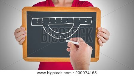 Digital composite of Hand drawing ruler on blackboard