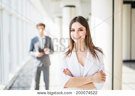 Young Attractive Business Woman With Crossed Hands In Front Of Business Man. Business Team