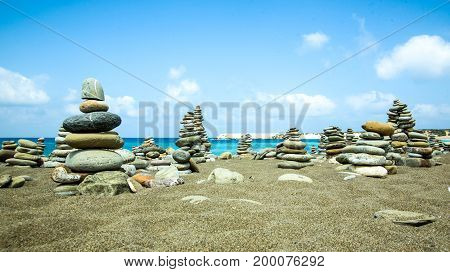 Stones pile on sea beach in cyprus