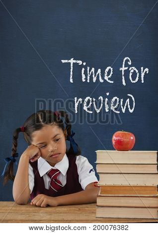 Digital composite of Bored student girl at table against blue blackboard with time for review text