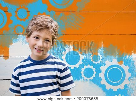 Digital composite of Boy in front of painted orange wall and settings cogs gears