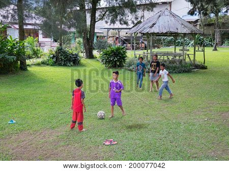 BERASTAGI INDONESIA 15 MAY 2017 : Indonesian children play football in countryside area of Berastagi city Northern Sumatra.
