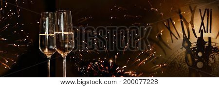 Panorama background New Year fireworks with champagne and clock to wish happiness