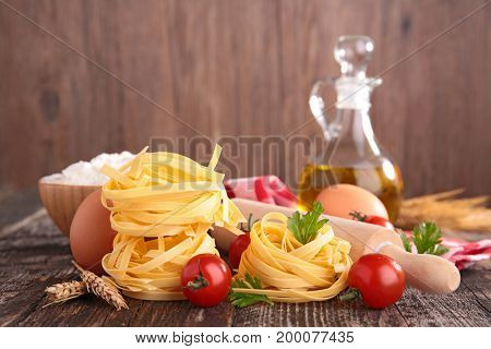 raw tagliatelle with ingredient and oil